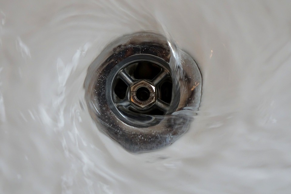 drain getting filled with drain cleaner to unclog it