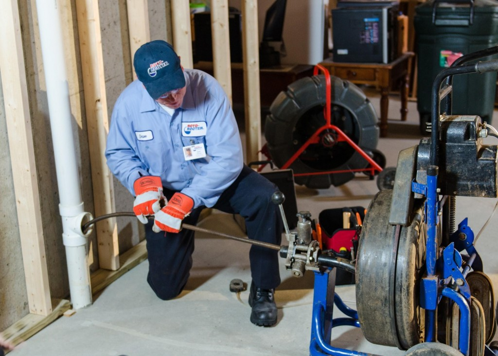 plumbing performing a sewer backup check